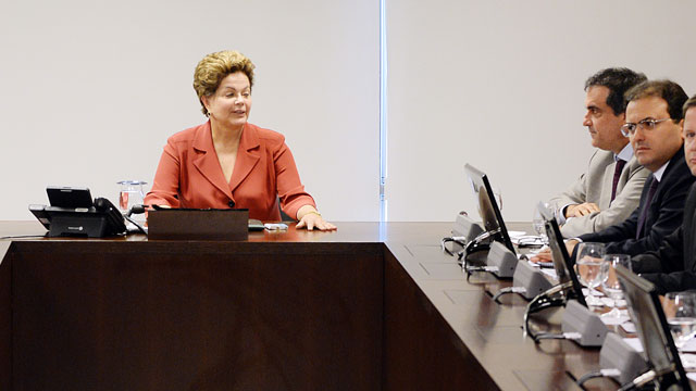 PHOTO: Brazilian President Dilma Rousseff(C) is seen during a meeting with Supreme Court and congressional leaders to gain support for her proposal for sweeping political reform in response to mass protests calling for a better quality of life.