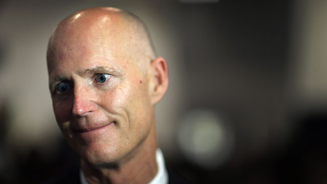 PHOTO:Florida Governor Rick Scott speaks to the media after signing Florida Senate Bill 52, legislation to ban texting while driving on May 28, 2013 in Miami, Florida.