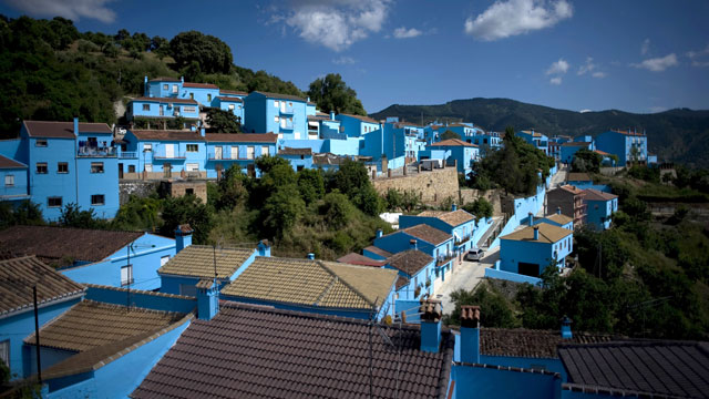 PHOTO:Smurf Blue. The village of Juzcar, Spain, had its homes painted blue, for a smurf movie premier in 2011. Tourists flooded the village, which now wants to stay blue, forever.