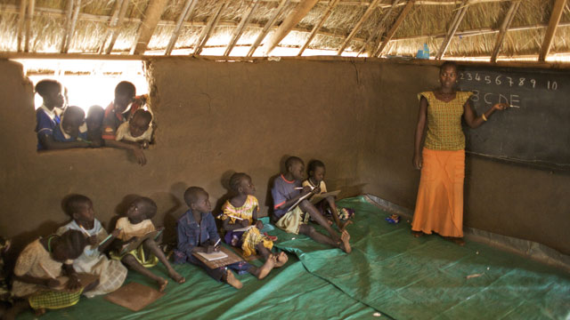 PHOTO:A teacher giving a class in a BRAC Non Formal Primary School, in the village of Hai Police, in Torid. Many children, who missed school due to decades of war and insecurity, are now attending BRAC schools in South Sudan.