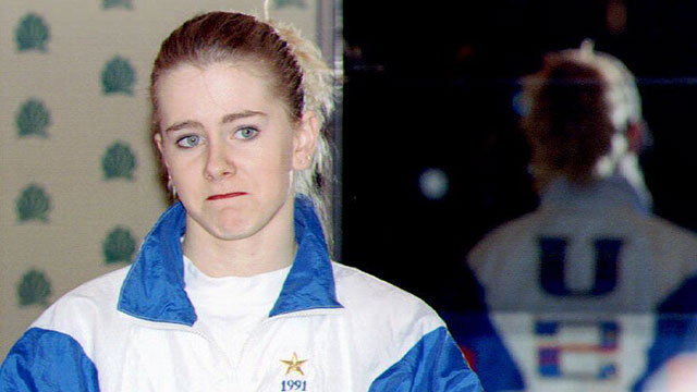 PHOTO:U.S. figure skater Tonya Harding reads from a prepared text 27 January 1994 during a press conference at the Multnomah County Athletic Club, Oregon.