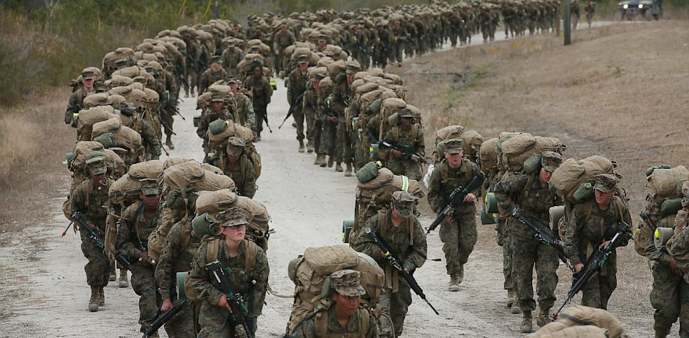 PHOTO: A company of Marines, both male and female, participate in a 10 kilometer training march carrying 55 pound packs during Marine Combat Training (MCT) on February 22, 2013 at Camp Lejeune, North Carolina.
