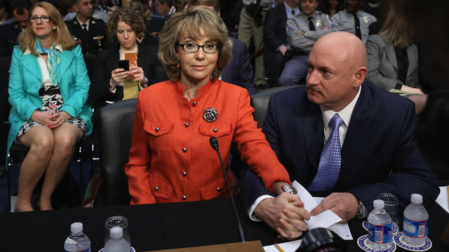 PHOTO: Retired NASA astronaut Mark Kelly (R) and his wife, shooting victim and former U.S. Rep. Gabby Giffords (D-AZ) prepares to give a statement before the Senate Judiciary Committee during a hearing on Capitol Hill January 30, 2013 in Washington, DC.