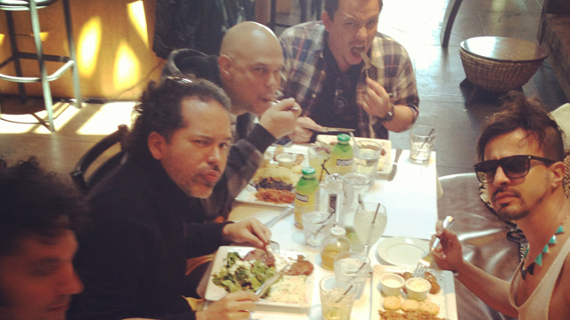 PHOTO: Band Los Amigos Invisibles feasting on Venezuelan deliciousness at Coupa Cafe in Beverly Hills.