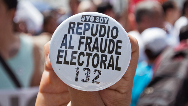 PHOTO:A protester holds a button during election fraud march in Mexico City on July 7, 2012.