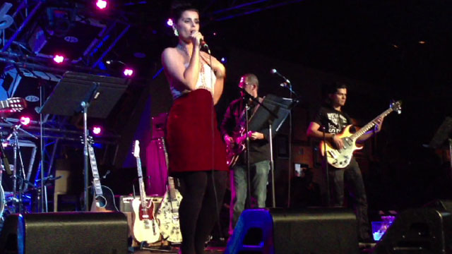 "Nelly Furtado sings ""La Isla Bonita"" at a charity event in Las Vegas during a pre-Latin Grammy event."