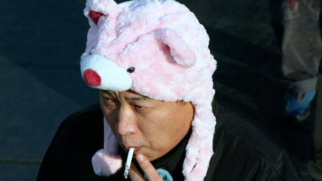 PHOTO: This man is in a fluffy animal hat.