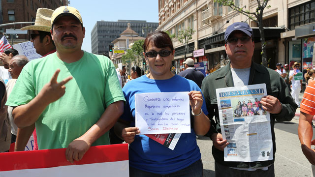 PHOTO: Armando Zesati (left), Nancy Torres and Felipe Marquez demonstrate at a May Day rally in Los Angeles.
