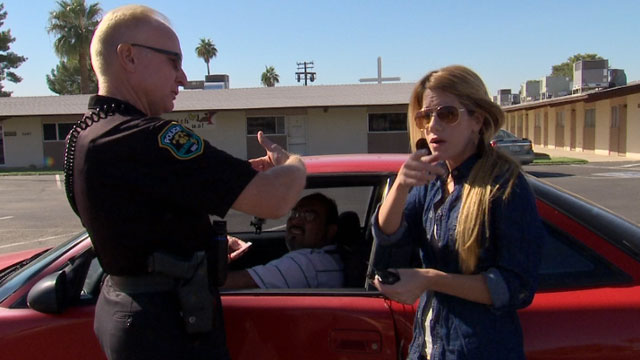 "Univisions reporter Andrea Sambuccetti talks to an officer in Phoenix, Arizona, after her producer was pulled over for ""impeding traffic""."