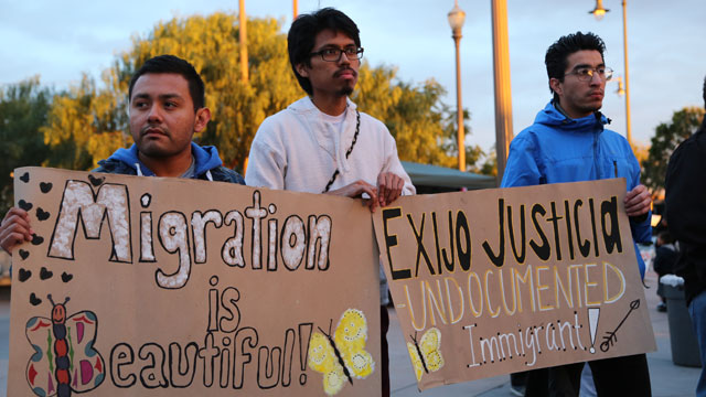PHOTO: Jose Mondragon (left) Jesus Daniel Mendez Carbajal and Manuel Enriquez hold signs in support of undocumented immigrants at a coming out rally in Los Angeles.