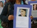 PHOTO:Demonstrators hold photographs of individuals who died at work.
