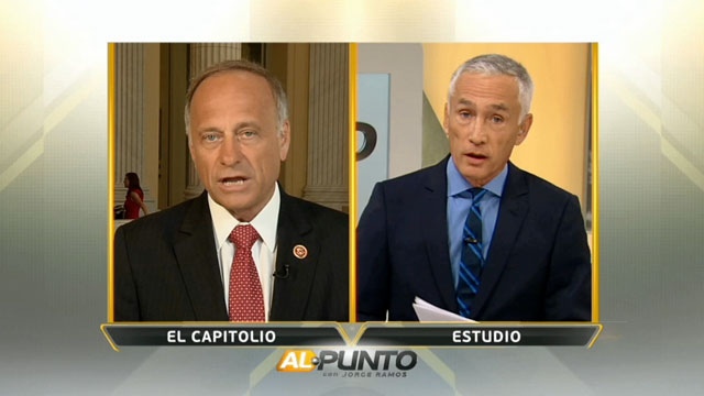 """PHOTO:Univisions Jorge Ramos (R) interviews Iowa Rep. Steve King (R-Iowa) (L) for the Sunday July 21, 2013 edition of """"Al Punto."""""""