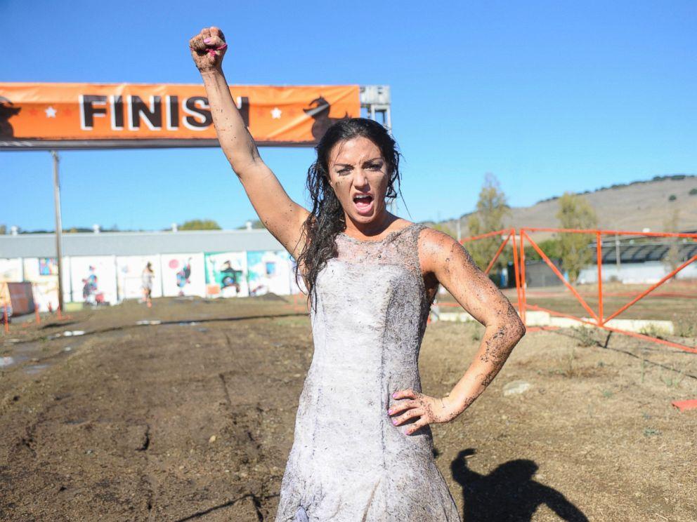 PHOTO: Jillian Anderson winning the mud run on The Bachelor.