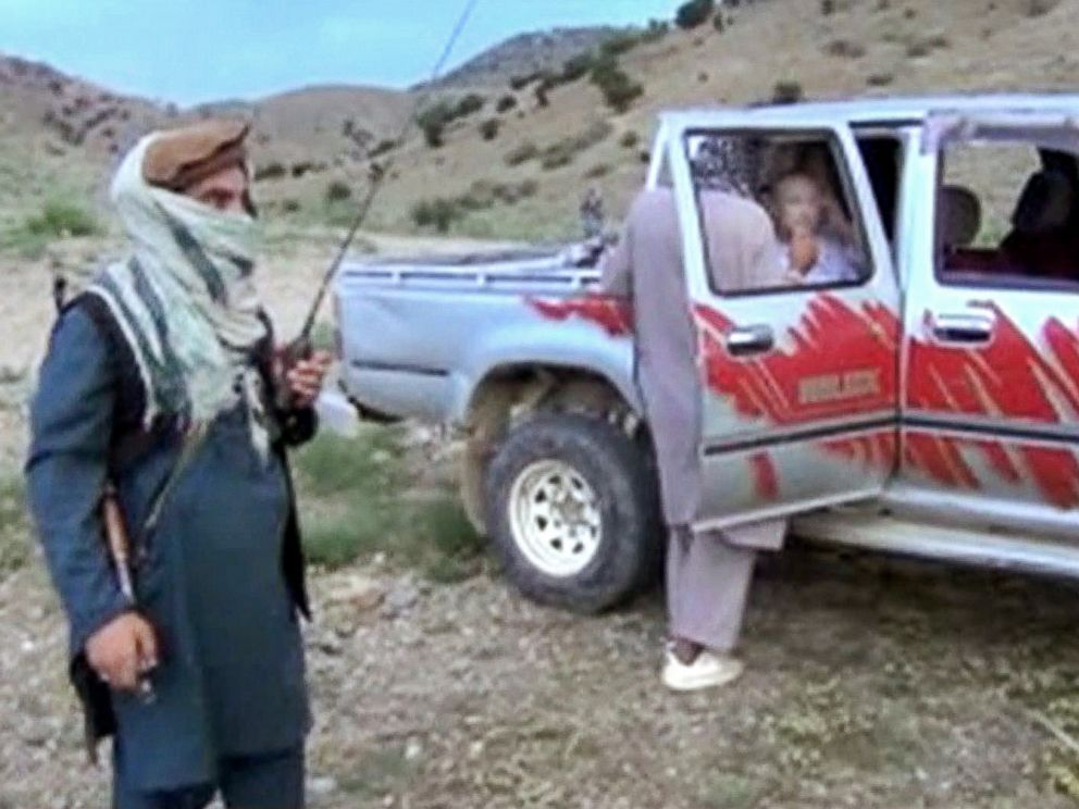 PHOTO: Sgt. Bowe Bergdahl sits in a vehicle guarded by the Taliban in eastern Afghanistan, in this image taken from video obtained from Voice Of Jihad Website, which has been authenticated based on its contents and other AP reporting.