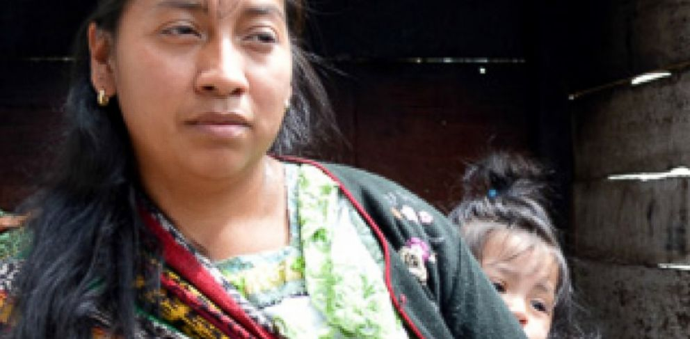 PHOTO: Alianza worker Magdalena, seen here with the younger of her two daughters.