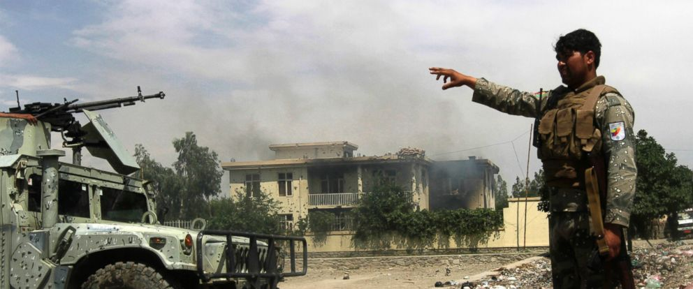 PHOTO: Afghan security forces arrive at the scene after Taliban fighters stormed a government building in Jalalabad province, May 12, 2014.