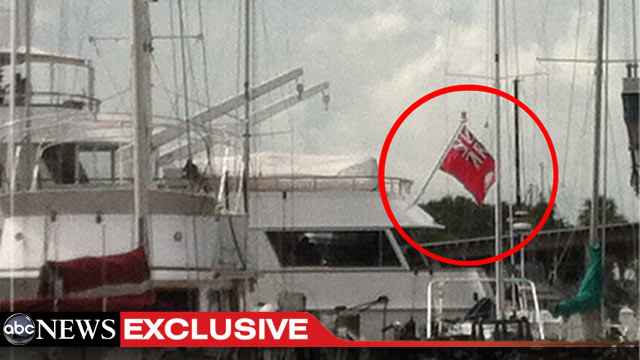 PHOTO: The yacht where elite donors of the Romney Victory Council are partying in Tampa flies a version of the Cayman Islands flag. Romneys use of offshore accounts for his investments has come under fire during the campaign.
