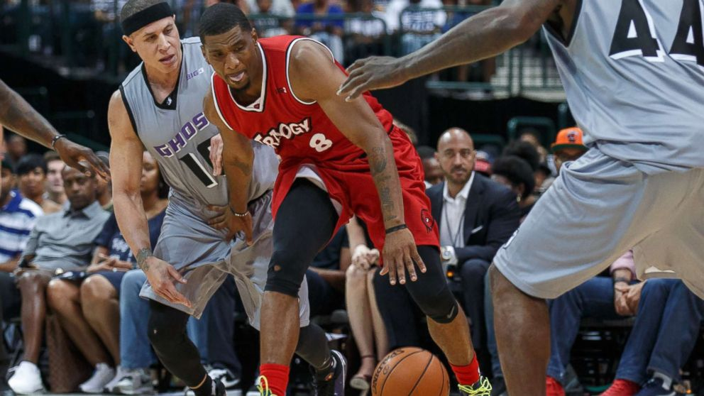 Trilogy guard James White dribbles as Ghost Ballers guard Mike Bibby and forward Ivan Johnson defend during the Big3 basketball game between the Ghost Ballers and Trilogy on July 30, 2017, at the American Airlines Center in Dallas, Texas.