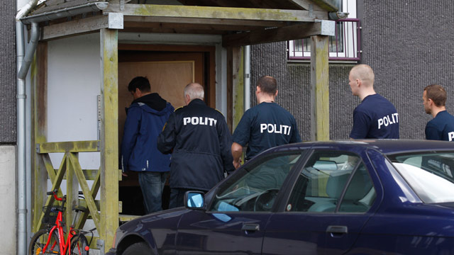 PHOTO: Danish police enter an appartment complex in Herlev, in the outskirts of Copenhagen, Denmark, for a search Friday, April 27, 2012.
