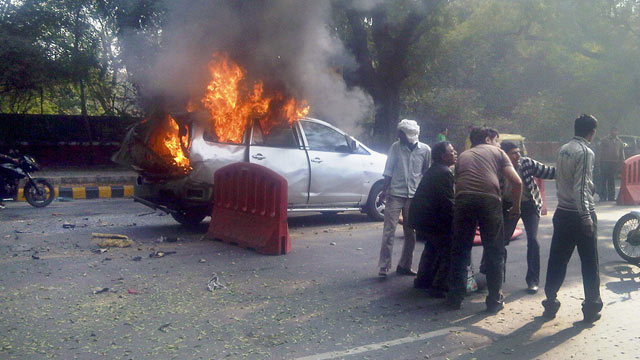 PHOTO: An injured person is carried from a burning car belonging to the Israeli Embassy following an explosion in New Delhi, India, Feb. 13, 2012.