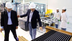 PHOTO: Abound Solar vice president Julian Hawkins, left, shows Secretary of the Interior Ken Salazar, second from left, finished solar panels during a tour of the solar manufacturing plant in Longmont, Colo., Aug. 4, 2009.