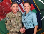 """PHOTO: Davis Petraeus, left, shaking hands with Paula Broadwell, co-author of  """"All In: The Education of General David Petraeus."""""""