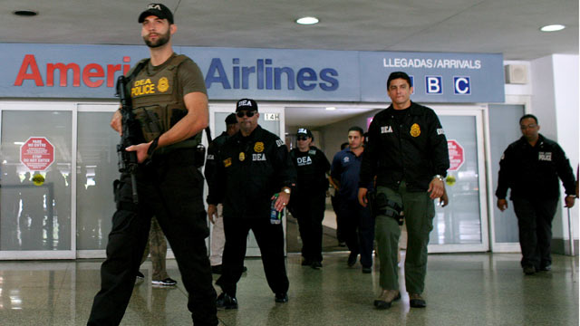 PHOTO: U.S. federal agents say they raided Puerto Ricos international airport and other areas early on June 6, 2012, arresting at least 33 people suspected of smuggling millions of dollars worth of drugs aboard commercial flights.