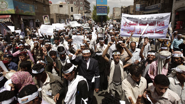PHOTO: Yemeni members of the Peaceful Revolution Salvation Front chant slogans during a demonstration demanding independence of the judicial system from government control, in Sanaa, Yemen, April 23, 2012.
