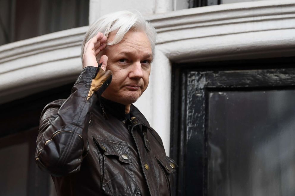 PHOTO: Wikileaks founder Julian Assange appears on the balcony after making an address to the media at the Embassy of Ecuador in London, May 19, 2017.
