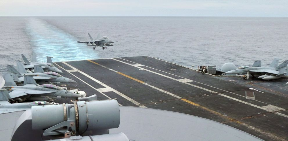 PHOTO: This photograph taken on October 24, 2013 in the South China Sea shows a US fighter jet making its landing on the USS George Washington aircraft carrier.