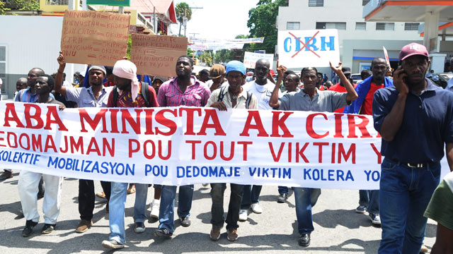 PHOTO: Haitians demonstrate in Port-au-Prince against the UN mission in Haiti and blame UN Peacekeepers of a cholera outbreak that began in 2010, Sept. 23, 2011.