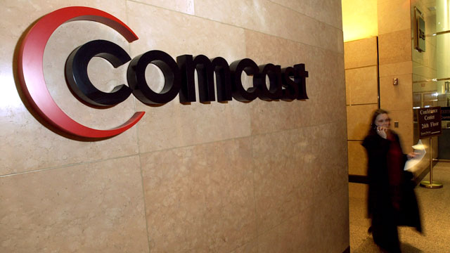 PHOTO: A Comcast logo hangs in the lobby of their corporate headquarters in Philadelphia.