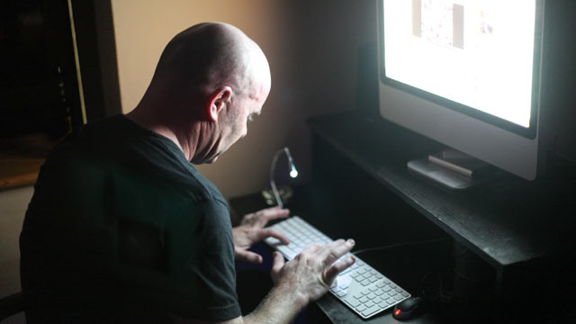 PHOTO: In this file photo, a man works on a computer.