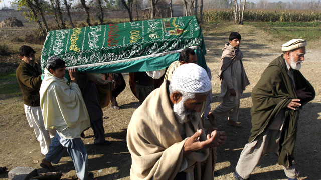 PHOTO: Mourners carry a coffin of a Pakistani charity worker, Jan. 2, 2013, who was killed with other colleagues during an attack by gunmen in Swabi. Seven charity workers were ambushed by gunmen on motorbikes as they were returning from a community centr