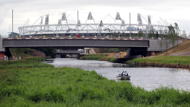 PHOTO: Police patrol on a waterway at the London 2012 Olympic Park, June 15, 2011 in London, England.