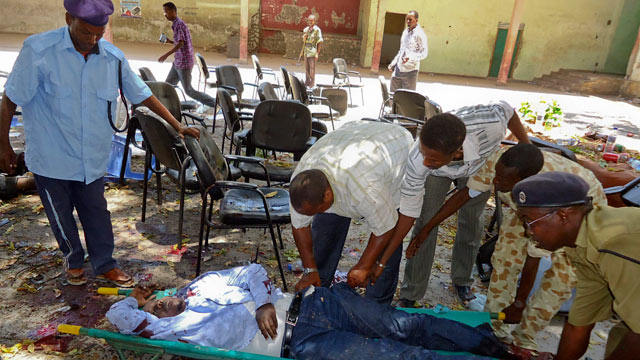 PHOTO: Somalis collect the body of a man killed in a blast at the Somali National Theater in Mogadishu, Somalia, April 4, 2012.