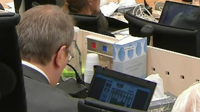 PHOTO: A camera captured a judge at the trial of Norway mass killer Anders Breivik playing solitaire on his computer during testimony.