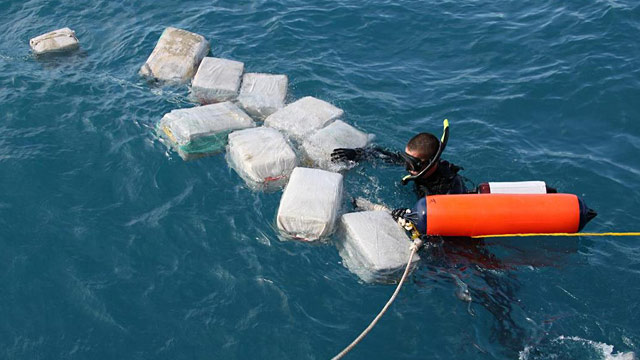 PHOTO: Diver recovering bales of cocaine