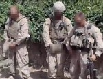 PHOTO: The video appears to show four men in uniform looking around before urinating on three dead bodies.