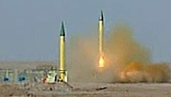 PHOTO: Iran's Islamic Revolution Guards Corps shot off missiles during a televised military drill.