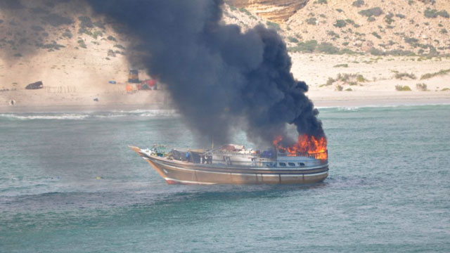 PHOTO: A pirate dhow burns off the Somali coast after a Dutch naval vessel fired upon it.