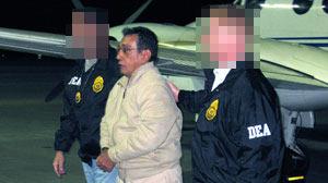 Mario Ernesto Villanueva Madrid is taken off a DEA jet in White Plains