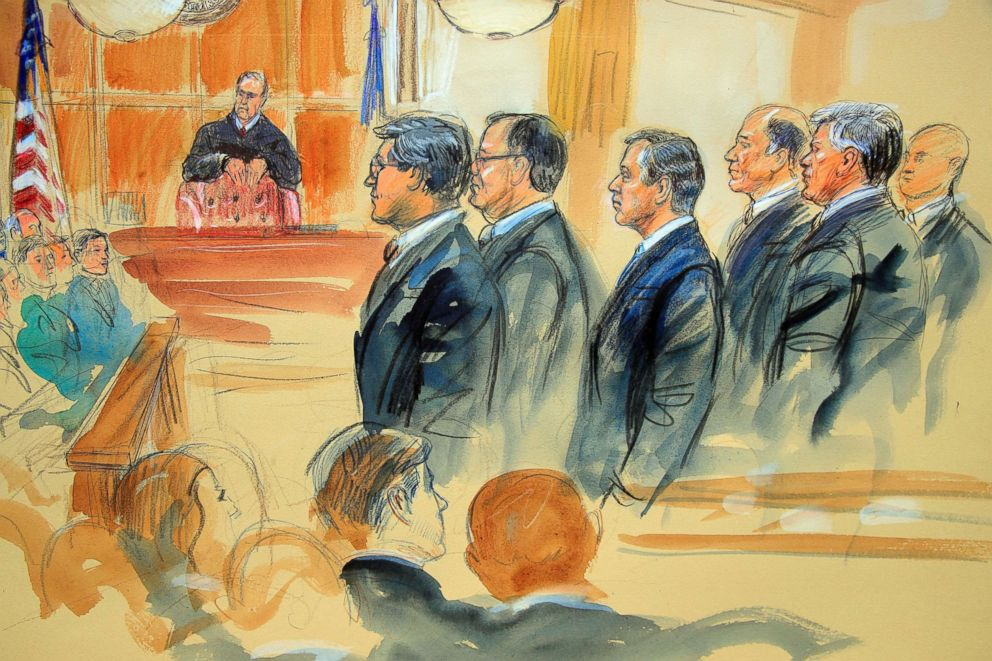 PHOTO: This courtroom sketch depicts Paul Manafort, fourth from right, standing with his lawyers in front of U.S. district Judge T.S Ellis III, and the jury during the jury selection of his trial in Alexandria, Va., July 31, 2018.