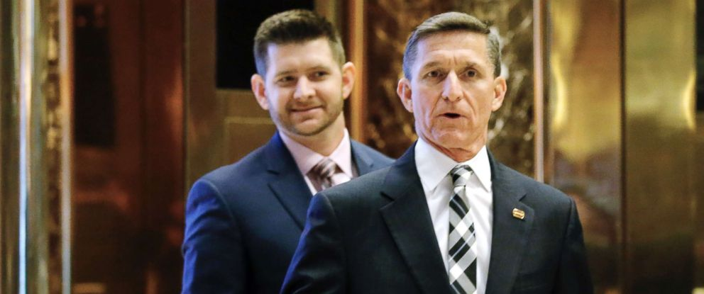 PHOTO: Michael Flynn Jr. is seen behind his father, retired Lt. Gen. Michael Flynn, as they arrive at Trump Tower in New York on Nov. 17, 2016.