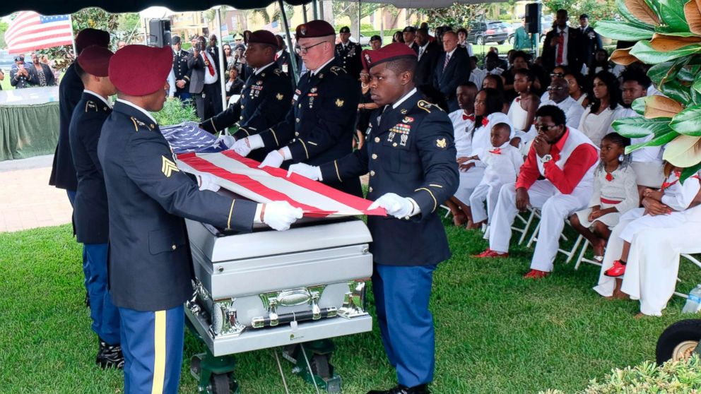 Members of the army honor guard fold the flag above the casket of US Army Sgt. La David Johnson during his burial service on October 21, 2017 in Hollywood, Florida. Johnson and three other US soldiers were killed in an ambush in Niger on October 4.