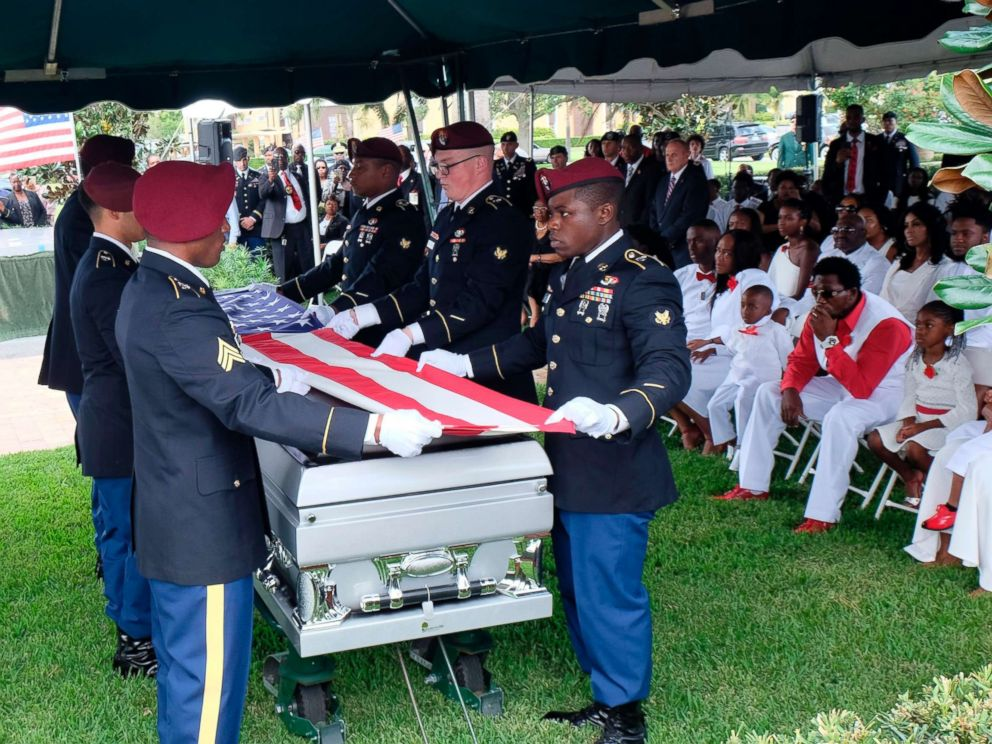 PHOTO: Members of the army honor guard fold the flag above the casket of US Army Sgt. La David Johnson during his burial service on October 21, 2017 in Hollywood, Florida. Johnson and three other US soldiers were killed in an ambush in Niger on October 4.