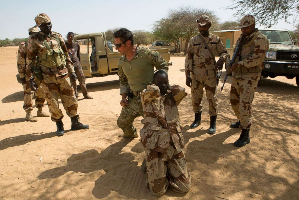 PHOTO: A U.S. special forces soldier demonstrates how to detain a suspect during a U.S.-led international training mission for African militaries, in Diffa, Niger, March 4, 2014.
