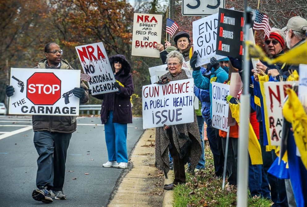 PHOTO: Demonstrators with the Virginia Gun Violence Prevention Coalition gather for their monthly protest/picket in front of NRA Headquarters to call for universal background checks and mourn those lost to gun violence, Nov., 14, 2015, in Fairfax, Va.