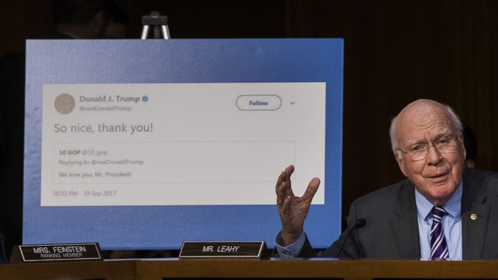 With a display showing President Donald Trump retweeting a fake Russian Twitter account, Sen. Patrick Leahy questions witnesses during a Senate Judiciary Subcommittee on Crime and Terrorism hearing on Capitol Hill, Oct. 31, 2017 in Washington.