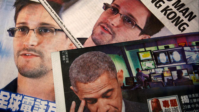 PHOTO: Photos of Edward Snowden, a contractor at the National Security Agency (NSA), and U.S. President Barack Obama are printed on the front pages of local English and Chinese newspapers in Hong Kong in this illustration photo June 11, 2013.
